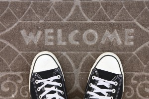 Welcome - converse shoes on carpet
