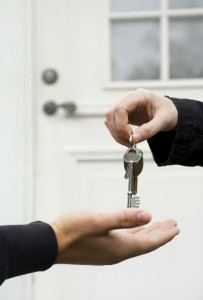 Person handing keys to another person