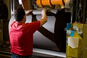 Paper rolls worker