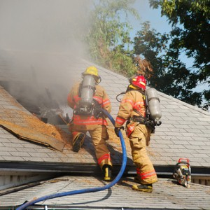 Arson firemen putting out fire