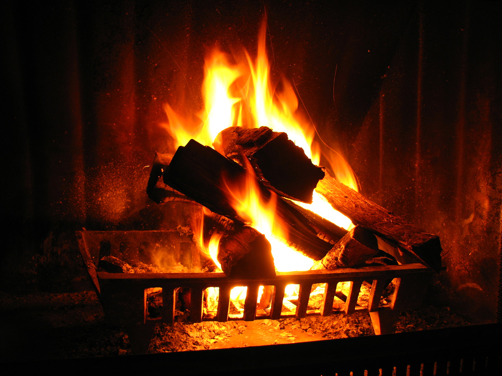 Photo of a fireplace and burning fire