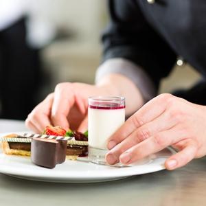 Women assembling desserts